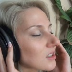 Blonde wearing headphones while having sex