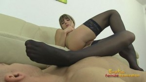 Foot fetish video of a stockinged domme teasing dick with her feet