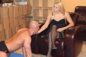 Obedient slave worships his queen's feet