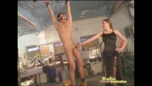 Dominatrix Ballbusts Male Slave Chained To Ceiling