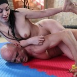 Beautiful Kiara pins down her slave during naked wrestling