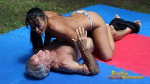 Elderly slave is knocked down by young Amazon during wrestling
