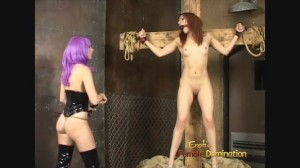 Crucified Female Slave Getting Her Punishment From a Mistress
