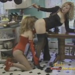 Lezdom mistress in black stockings ordering to a handsome female slave