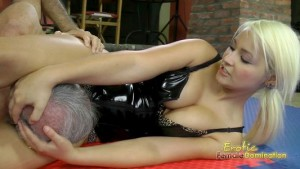 Strong Girl In Black PVC Corset Wrestling Video