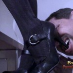 Glamourous dominatrix demanding to lick her sexy high heel shoes
