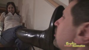 Submissive slave made to lick leather boots