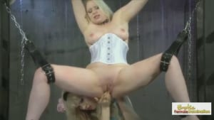 Blonde dominatrix teases and fists her pretty, busty slave