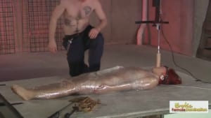 Redhead slave is wrapped in plastic before being fucked by her Master