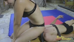 Female wrestler Orsi pins and binds her male opponent