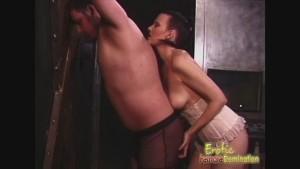 A patient dominatrix waits to spank a submissive man