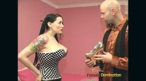Woman dressed as a real pin up girl whipping her personal fem-dom slave