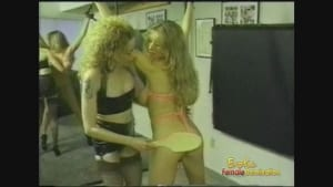 Blonde Mistress whips and binds her busty slave