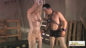 Blonde slave's nipples and clit are targeted by her dominant man