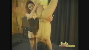 A Mistress has fun with her slender slave, bound upside-down