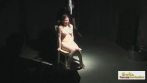 Captured redhead is given a unique interrogation by a sadist with a vibrator