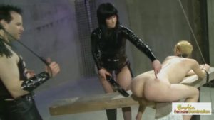 Tomboy slave double-teamed by Master and Mistress